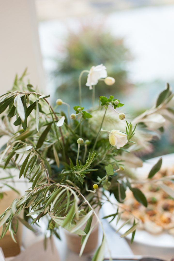 Olive branch and poppy floral arrangement by Teressa Johnson.